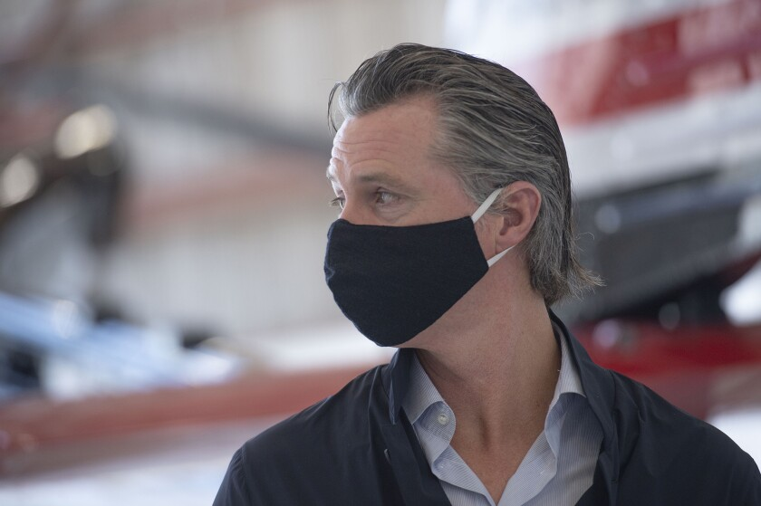 California Gov. Gavin Newsom wears a face mask.