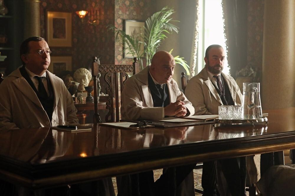 """Dr. Lydgate (center) and other doctors (Michael Q. Adams, Jonny Coyne, Ryan Elm) keep Alice in a behavioral facility in """"Once Upon a Time in Wonderland."""""""