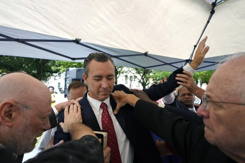 People praying with Louisiana pastor Tony Spell