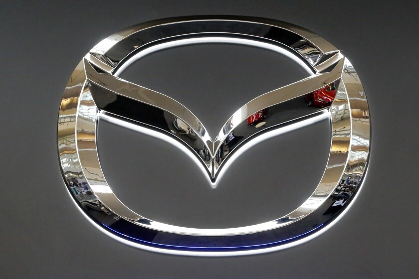 This is the Mazda logo on display at the Pittsburgh Auto Show Thursday, Feb. 15, 2018. Mazda is recalling nearly 261,000 older small cars in the U.S. because a plastic emblem on the steering wheel can shatter if the air bags are inflated, causing injuries. The recall covers certain Mazda 3 cars from the 2004 through 2007 model years. Mazda says in documents posted Thursday, July 8, 2021 by U.S. safety regulators that the emblem can shatter and send plastic fragments into the vehicles. (AP Photo/Gene J. Puskar, file)