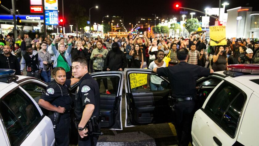 Protesters stare down Los Angeles police officers during a November 2014 demonstration against a Missouri grand jury's decision not to indict the officer who fatally shot Michael Brown. Protests erupted across the country following the announcement.