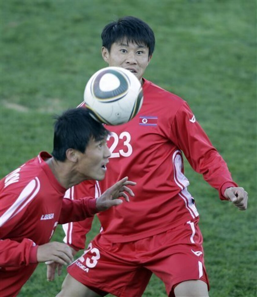North Korea's  Ri Kwang Chon, left, and Jong Tae Se challenge for the ball during a team training session in Tembisa near Johannesburg, South Africa,  Tuesday June 8, 2010. North Korea  are preparing for the upcoming soccer World Cup, where they will play in Group G. (AP Photo/Frank Augstein)