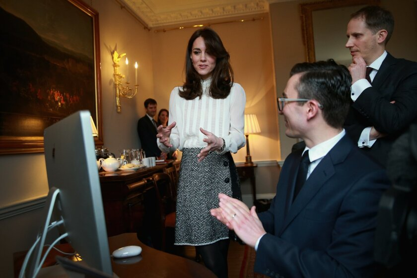 "Kate, Duchess of Cambridge talks with the Executive Editor of the Huff Post UK, James Martin, centre, and Editor in Chief Huff Post UK, Steven Hull, right, after launching a story on ""Early Intervention in Mental Health Care"" on the Huffington Post landing page in the ""News Room"" at Kensington Pala"