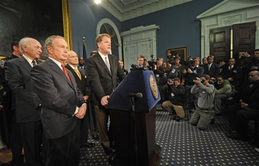US Airways CEO Doug Parker speaks to the media during a press conference at City Hall as Fire Commissioner Vincent Scoppetta, left, Mayor Michael Bloomberg, foreground, and Police Commissioner Raymond Kelly,behind Bloomberg,  look on, Friday, Jan. 16, 2009, in New York. Rescuers from  Flight 1549 w
