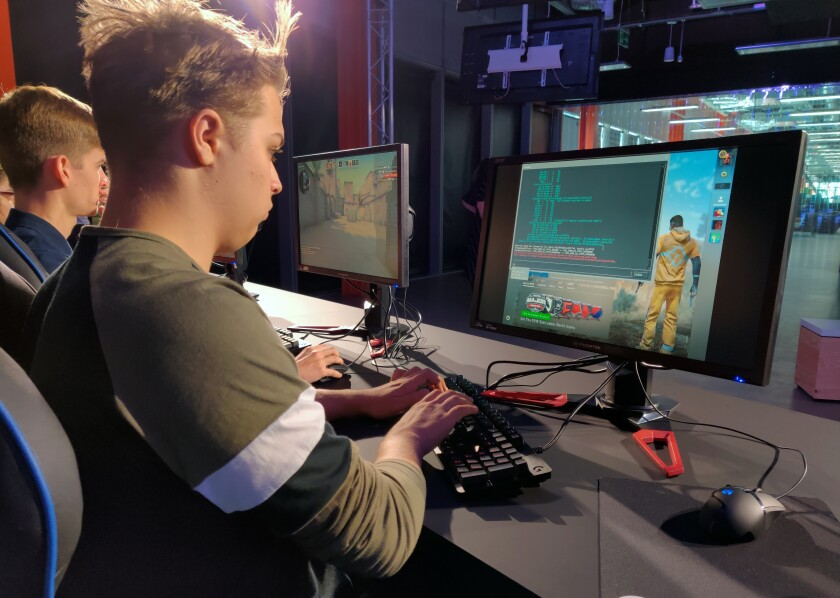 """In this photo taken on Sept. 17, 2019, Ryan Chapman and other students starting Staffordshire University's esports degree course play """"Counter-Strike"""" in the school's new London digital studio. A number of U.K. and U.S. universities are launching degrees in esports, or competitive multiplayer videogaming, to capitalize on the booming industry's growing demand for skilled professionals. (AP Photo/Kelvin Chang)"""