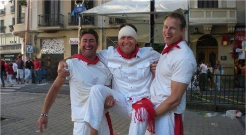 Kyle Streckert, Hal Streckert and Paul Clark in Pamplona, Spain, after Hal was almost trampled by a bull.