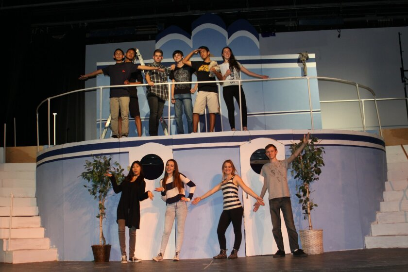 Cast and crew members on the 'boat' on which 'Anything Goes' takes place, docked on the La Jolla High School stage.