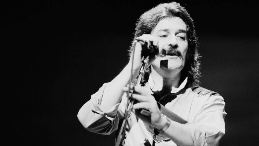 Singer and flautist Ray Thomas performing with English rock group Moody Blues in 1981.