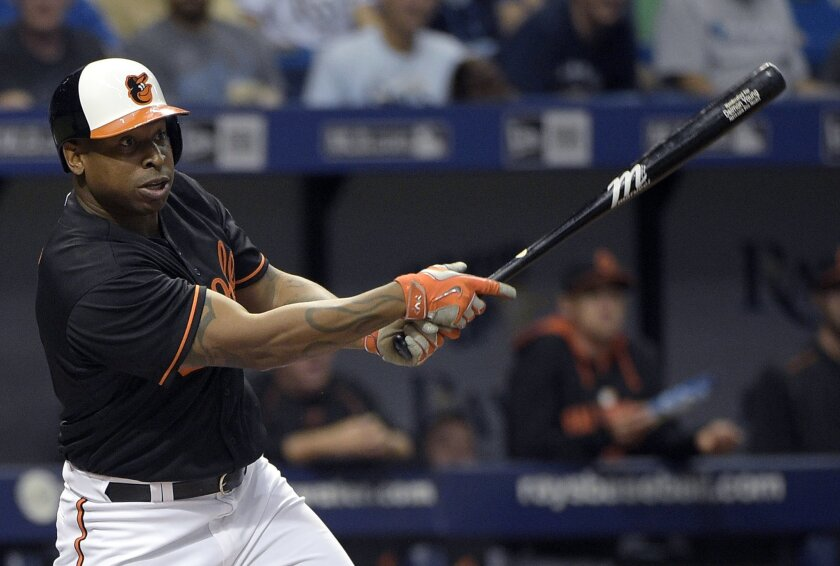 FILE - In this May 1, 2015, file photo, Baltimore Orioles' Delmon Young fouls off a pitch during the ninth inning of a baseball game against the Tampa Bay Rays in St. Petersburg, Fla. Major League Baseball player Young was arrested after authorities say he choked and threatened a parking attendant