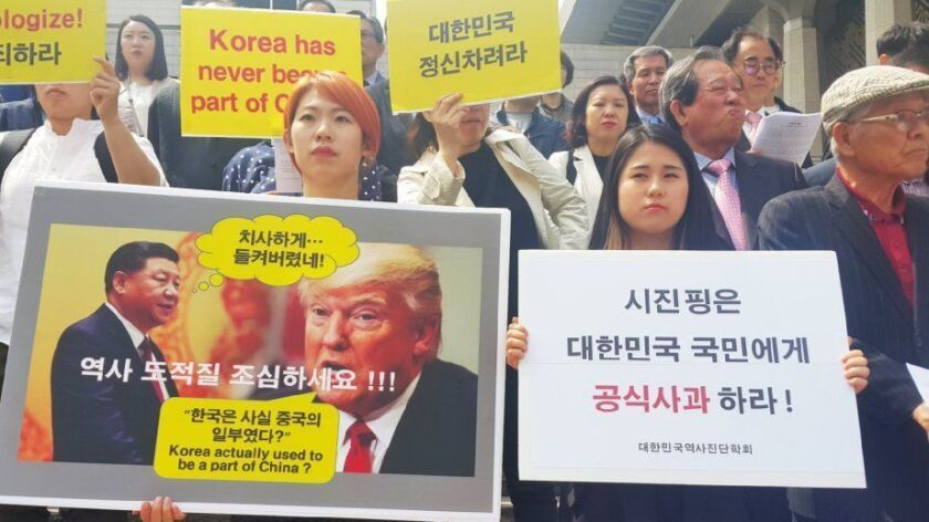 epa05918623 South Korean activists from civilian history organizations rebuke Chinese President Xi J