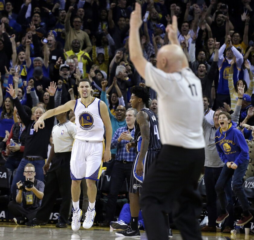 Golden State's Klay Thompson celebrates a score against Orlando on Dec. 2, 2014, in Oakland.