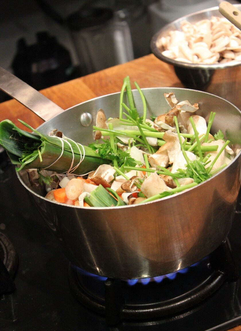 Cooking scraps are simmered to make a rich, layered broth that ultimately becomes the base for a decadent sauce.