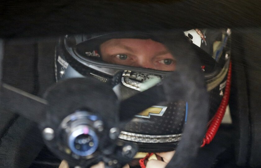 Dale Earnhardt Jr. sits in his car in the garage during a practice session for the NASCAR Daytona 500 auto race at Daytona International Speedway, Saturday, Feb. 13, 2016, in Daytona Beach, Fla. (AP Photo/Terry Renna)
