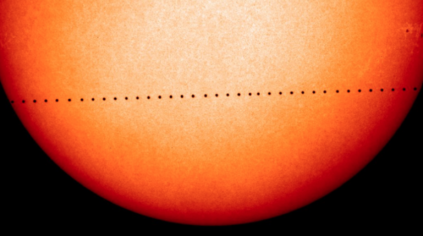 A composite image of observations by NASA and the ESA's Solar and Heliospheric Observatory shows the path of Mercury during its November 2006 transit.