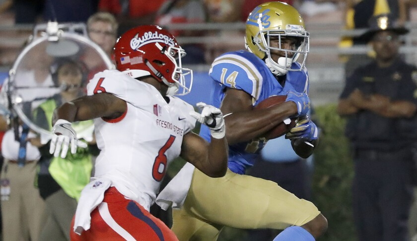 UCLA wide receiver Theo Howard breaks away for a touchdown against Fresno State during a game in 2017.
