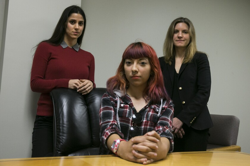 Compton Unified student Kimberly Cervantes, center, is part of a groundbreaking class-action lawsuit seeking academic and counseling services from the district, where students allegedly are suffering from extensive trauma, which research shows incapacitates learning. The lawsuit is the first of its kind in the nation. Left to right are; attorney Annie Hudson-Price, Cervantes and attorney Kathryn Eidmann.