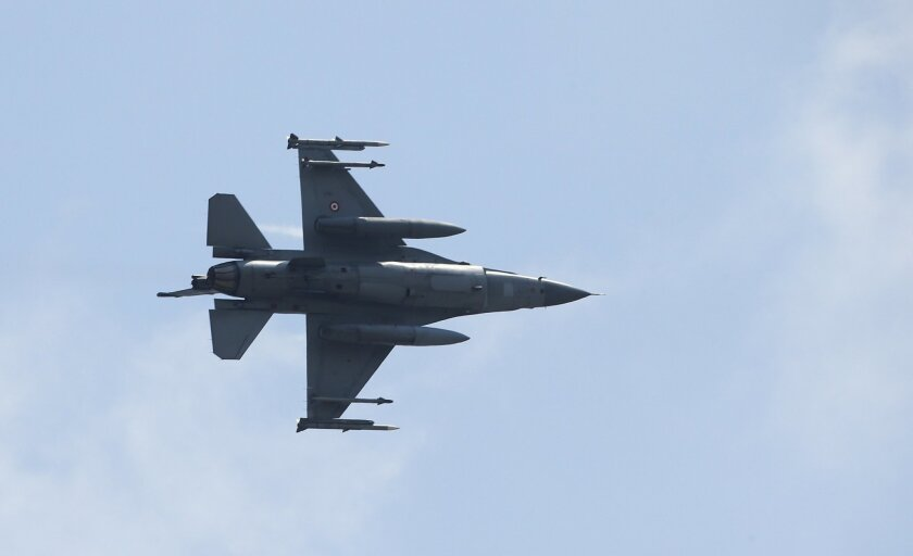 A missile-loaded Turkish Air Force warplane takes off from the Incirlik Air Base, in the outskirts Adana, south-eastern Turkey, Tuesday, July 28, 2015. After months of reluctance, Turkish warplanes last week started striking militant targets in Syria and agreed to allow the U.S. to launch its own strikes from Turkey's strategically located Incirlik Air Base. In a series of cross-border strikes, Turkey has not only targeted the IS group but also Kurdish fighters affiliated with forces battling IS in Syria and Iraq. (AP Photo/Emrah Gurel)