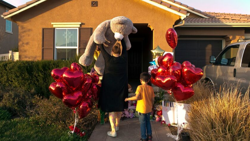 Neighbors of the Turpin family on Jan. 18 drop off a gift at the home of the 13 children who were allegedly abused and neglected by their parents.