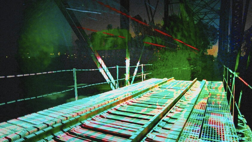 """Rails bathed in color, called """"Light Echoes,"""" by Aaron Koblin and Ben Tricklebank are part of the one-minute scenes from the """"Station to Station"""" train journey by Doug Aitken and his artistic companions."""