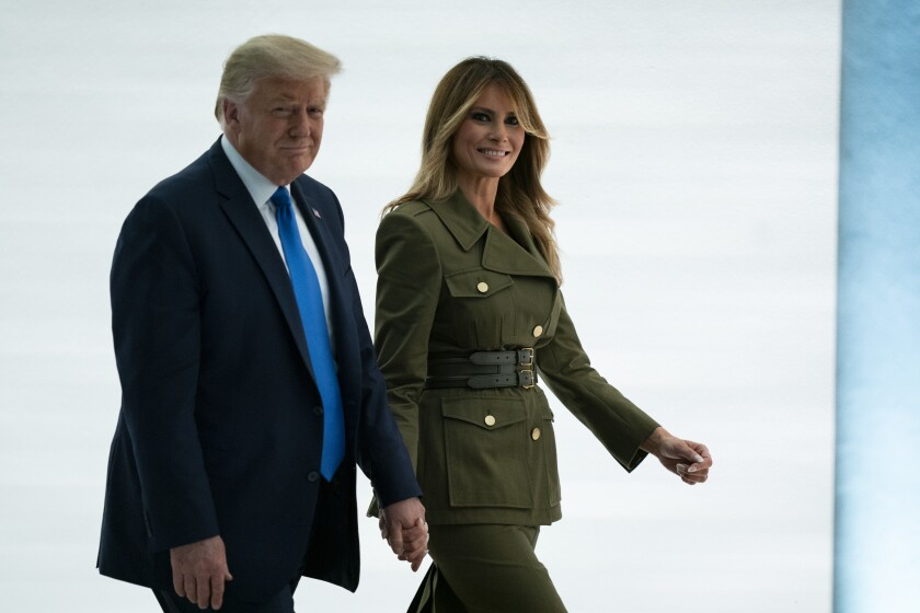 President Trump walks with Melania Trump after her speech to the 2020 Republican National Convention.