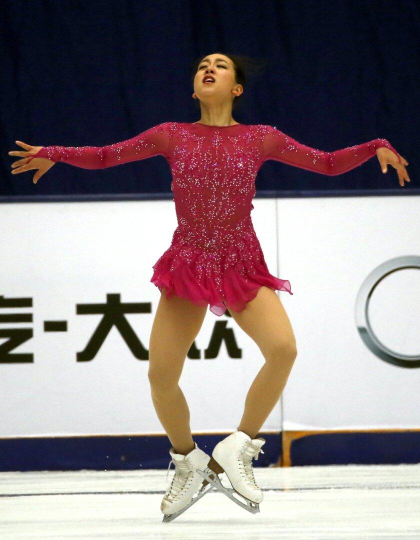 Japan's Mao Asada competes in the Ladies Short program during the ISU Grand Prix of Figure Skating held at the Capital Gymnasium in Beijing, China, Friday, Nov. 6, 2015. (AP Photo/Ng Han Guan)