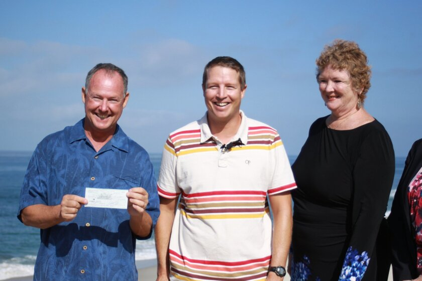 District 9 City Councilmember Marti Emerald (right) kicks off the fundraiser by presenting a check to Ed Harris (left) and Gareth 'Chappy' Chapman.