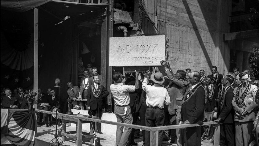 June 22, 1927: The cornerstone of the new Los Angeles City Hall is seated during ceremonies at the c