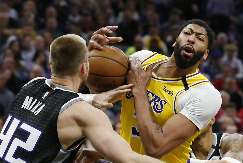 Anthony Davis is fouled by the Kings' Eric Mika during the Lakers' 129-113 win Feb. 1, 2020.