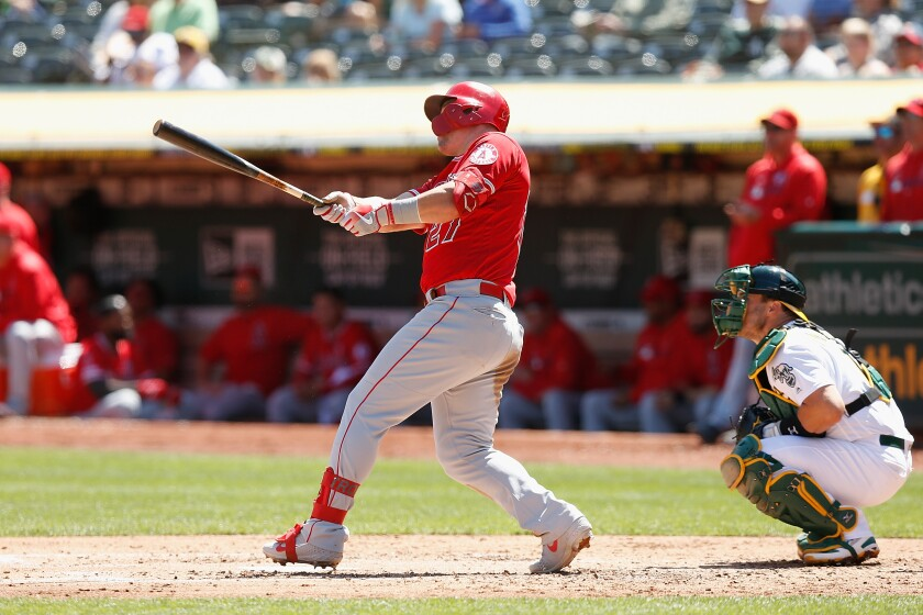 Angels' Mike Trout hits a two-run home run in the top of the third inning against the Oakland Athletics on Thursday in Oakland.