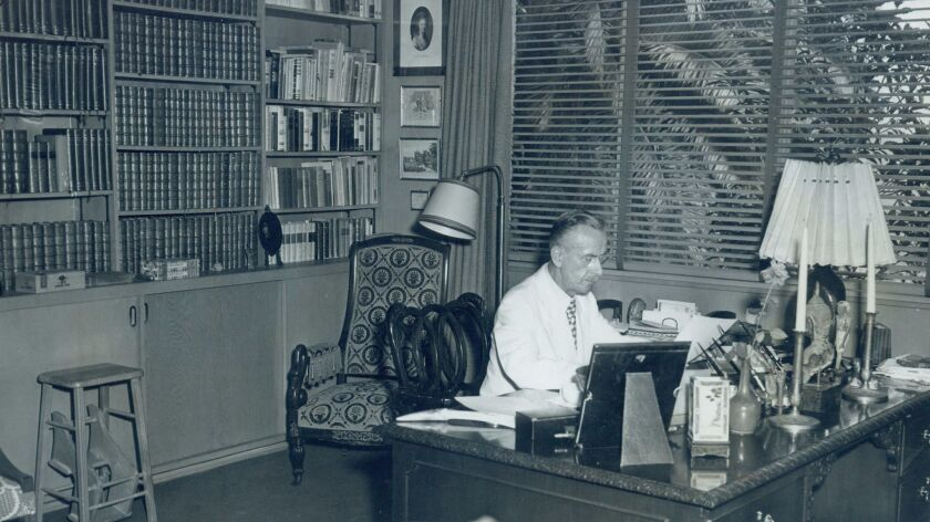 Thomas Mann working in 1945 in his Pacific Palisades house, designed by architect J.R. Davidson.