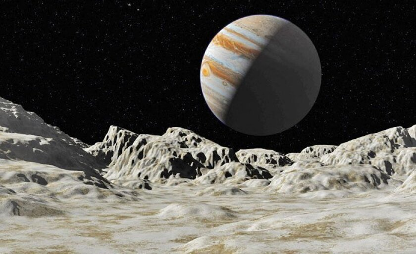 Jupiter's moon Europa (seen in an artist's rendering) and Saturn's moon Titan have both been targets in the search for alien life. Now NASA has chosen Europa as the destination of an unmanned probe. (NASA images)