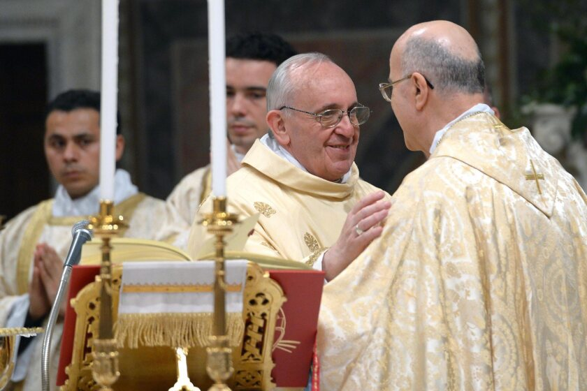 Pope Francis, center, formerly Argentine Cardinal Jorge Mario Bergoglio, leads a Mass at St. Peter's Basilica at the Vatican.