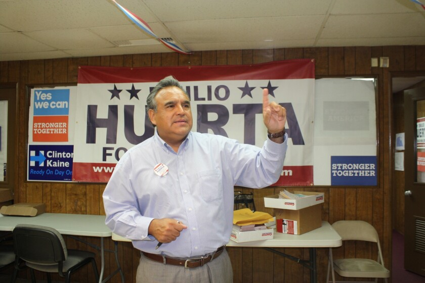 Democratic attorney Emilio Huerta gestures to staff during a tour of his Bakersfield campaign office.