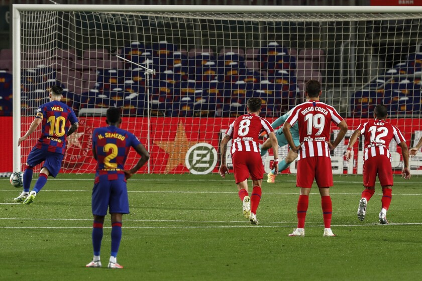 Barcelona's Lionel Messi, left, scores his side's second goal on a penalty kick during the Spanish La Liga soccer match between FC Barcelona and Atletico Madrid at the Camp Nou stadium in Barcelona, Spain, Tuesday, June 30, 2020. (AP Photo/Joan Monfort)