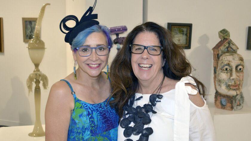 Co-hosting last week's opening night reception were arts center director Virginia Causton-Keene, l