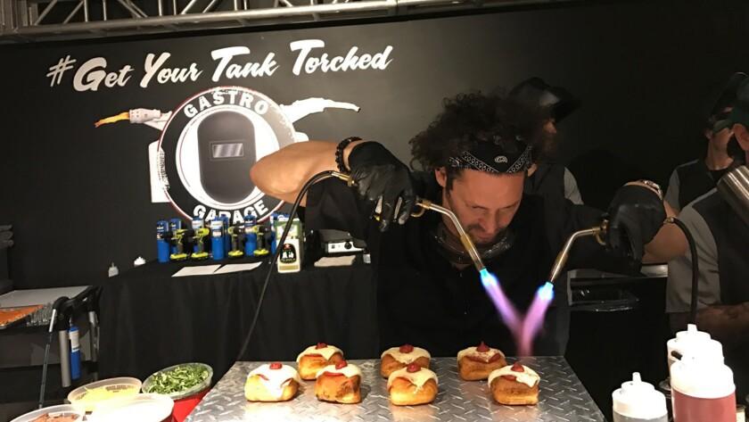Gastro Garage co-owner Adam Manacker torching doughnuts.