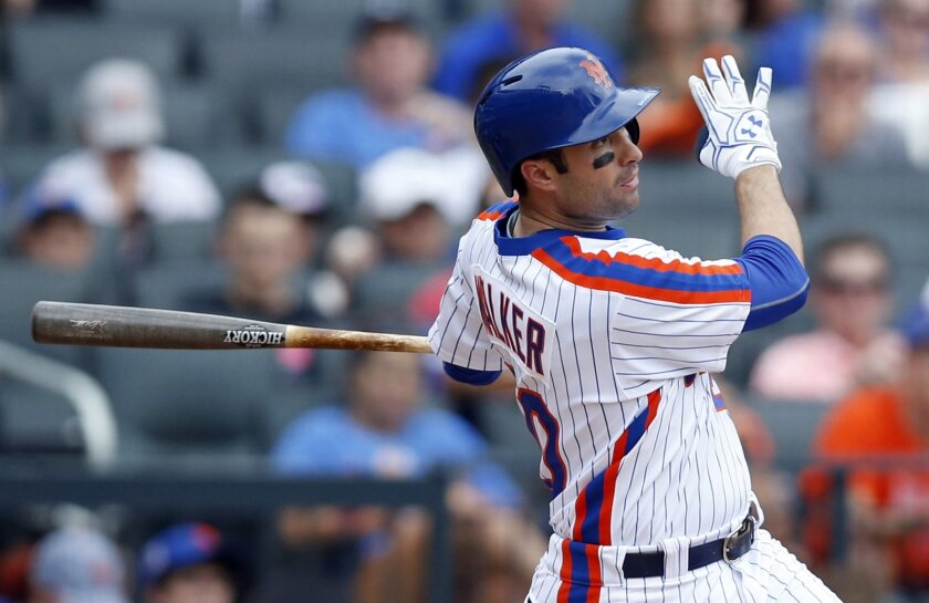 New York Mets' Neil Walker hits a seventh-inning three-run home run in a baseball game against the Colorado Rockies, Sunday, July 31, 2016, in New York. (AP Photo/Kathy Willens)