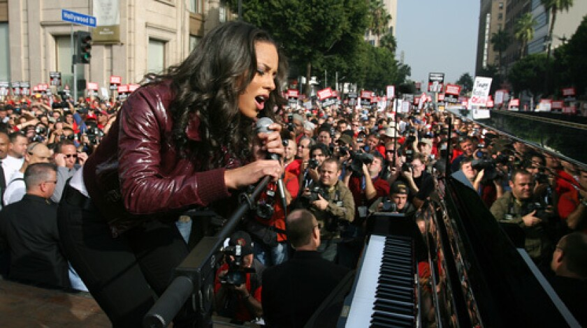 Singer Alicia Keys performs during a protest in support of the WGA on Hollywood Boulevard.