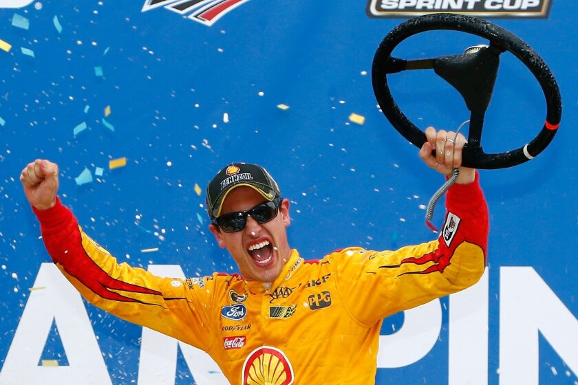 Logano wins controversial Talladega finish; Earnhardt eliminated from Chase