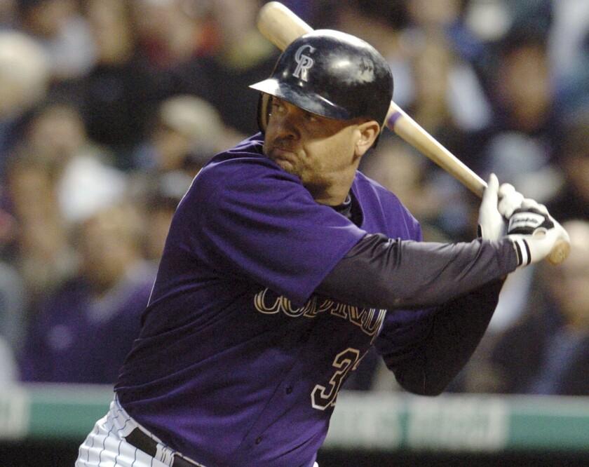 Larry Walker at the plate for the Colorado Rockies in 2004. Walker earned baseball's highest honor Jan. 21.