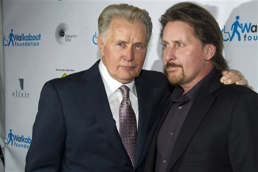 "Martin Sheen, left, and Emilio Estevez attend the premiere of ""The Way"", in New York, Wednesday, Oct. 5, 2011. (AP Photo/Charles Sykes)"