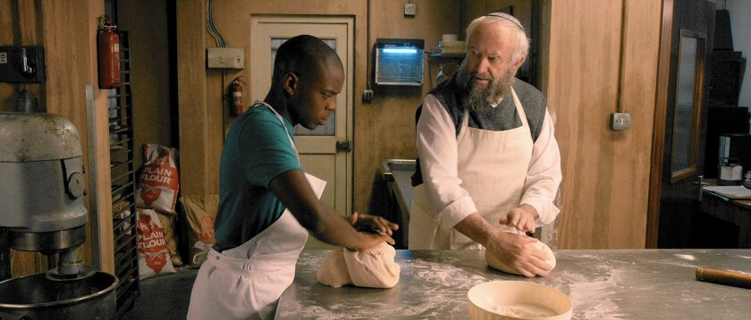 "Jerome Holder, left, and Jonathan Pryce in ""Dough."""
