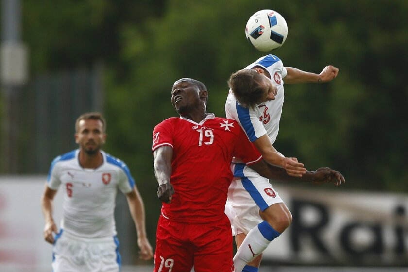 Alfred Effiong from Malta, left, and David Pavelka of Czech Republic challenge for the ball during a friendly soccer match between Czech Republic and Malta in Kufstein, Austria, Friday, May 27, 2016. The Czech Republic National Football Team is in Austria for a training camp in preparation for the