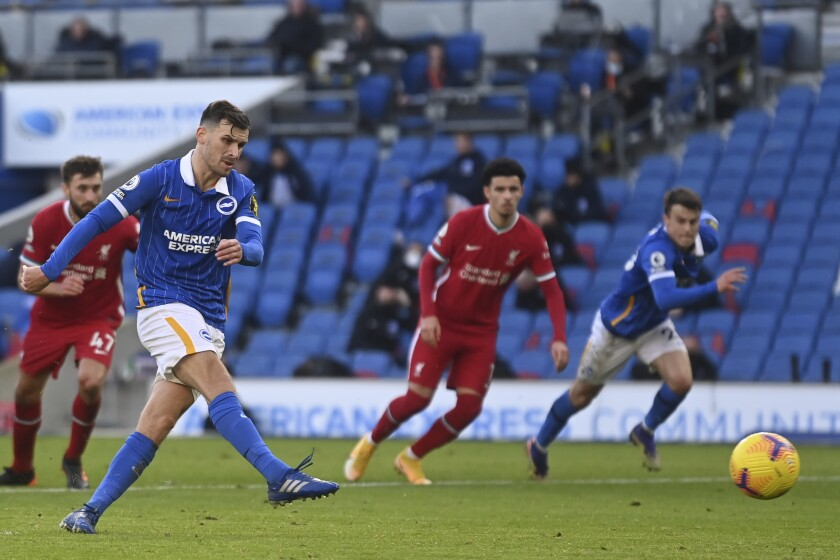 Brighton's Pascal Gross, second from left, scores the equalizer on a penalty kick during the English Premier League soccer match between Brighton and Hove Albion and Liverpool at the Amex stadium in Brighton, England, Saturday, Nov. 28, 2020. (Neil Hall/Pool Via AP)