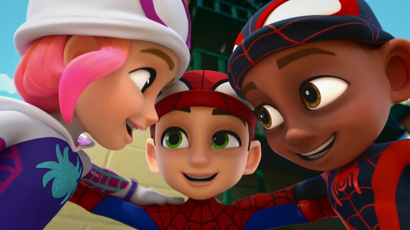 A girl and two boy superheroes, their masks rolled up to reveal their faces, lean in for a huddle.