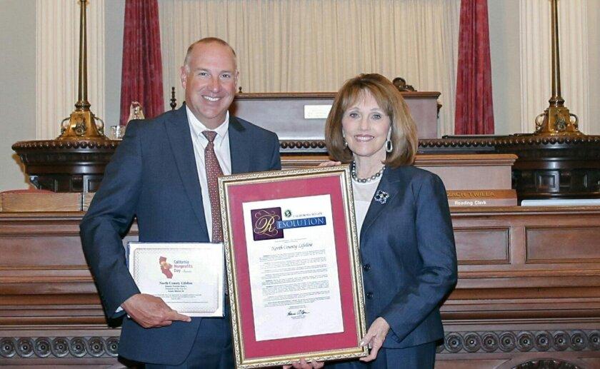North County Lifeline was named 2016 Nonprofit of the Year. Senator Patricia Bates (R-Laguna Niguel) congratulates North County Lifeline's executive director Don Stump.