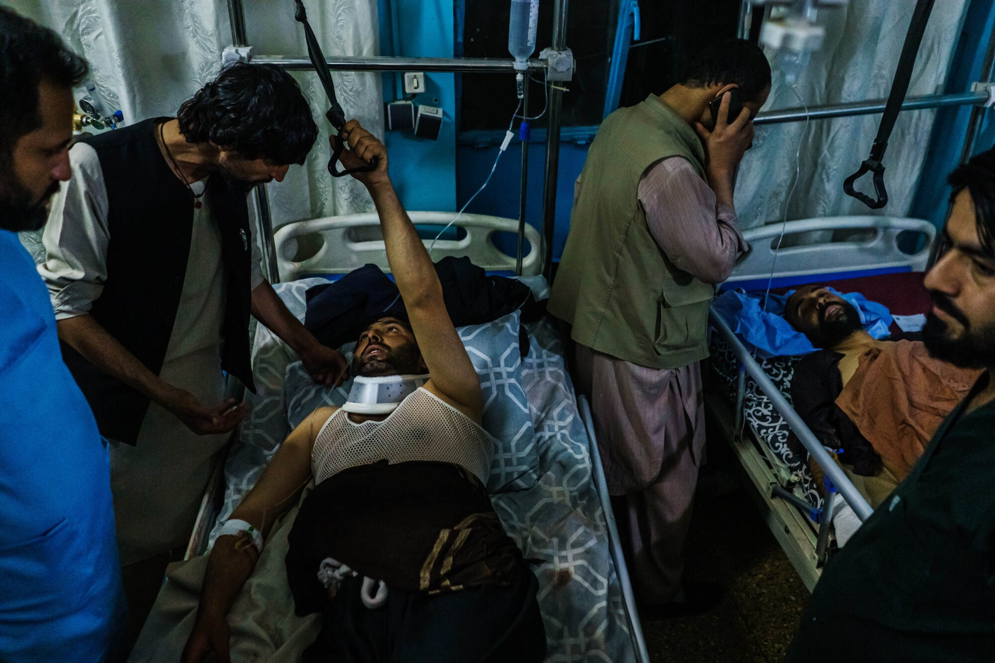 Family members visit wounded patients who have been admitted into Wazir Akbar Khan Hospital