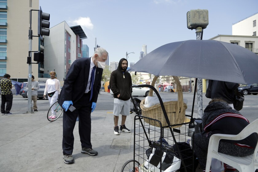 Judge David O. Carter asks a skid row resident how long the water dispensers have been dry