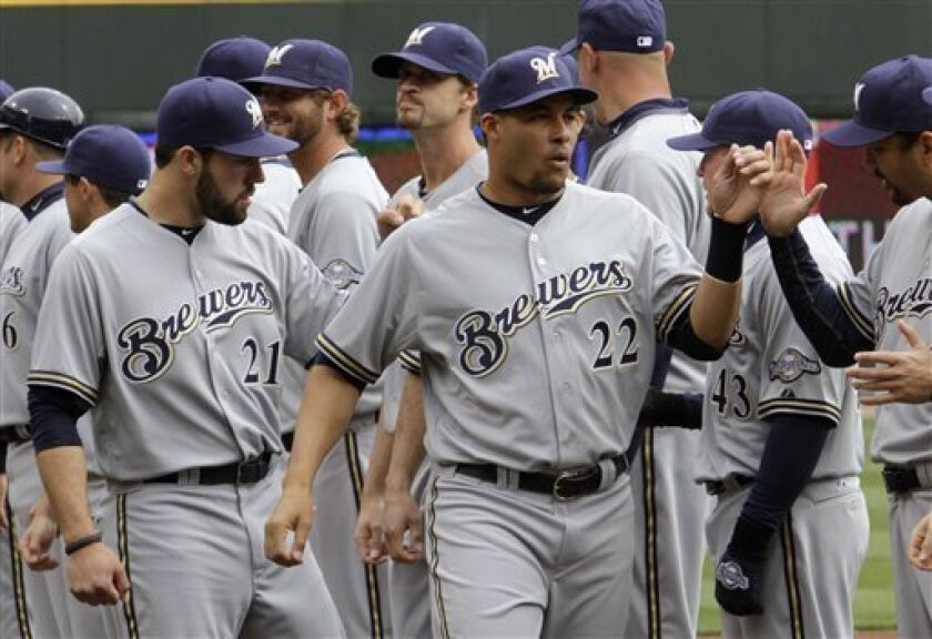 Milwaukee Brewers shortstop Erick Almonte (22) and relief pitcher Zach Braddock (21) are introduced prior to their opening day baseball game against the Cincinnati Reds, Thursday, March 31, 2011 in Cincinnati. (AP Photo/Al Behrman)