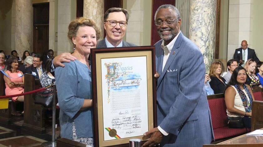 La Cañada resident Royal Oakes, center, with wife Lauren, received a proclamation from the L.A. City Council, presented by Councilman Curren Price, for providing commentary on high profile cases involving O.J. Simpson, Casey Anthony, Rodney King, and others.